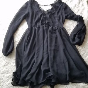 Black sexy ruffle mini dress size 0 EUC shear